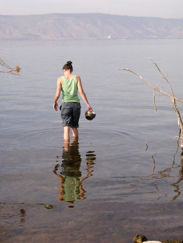 Collecting water for cooking in the Sea of Galilee, Israel