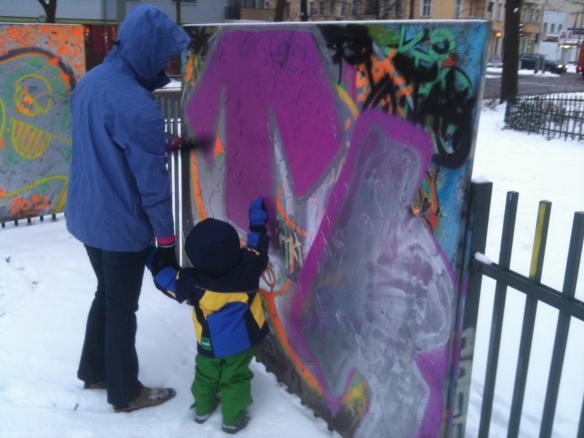 Amaya checking out the Graffiti in the park across from our unit.