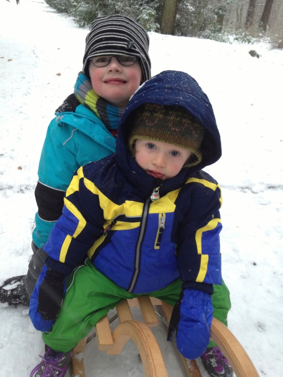 Amaya and her new friend Benjamin enjoying being pulled along on a sled - beats a pram any day!