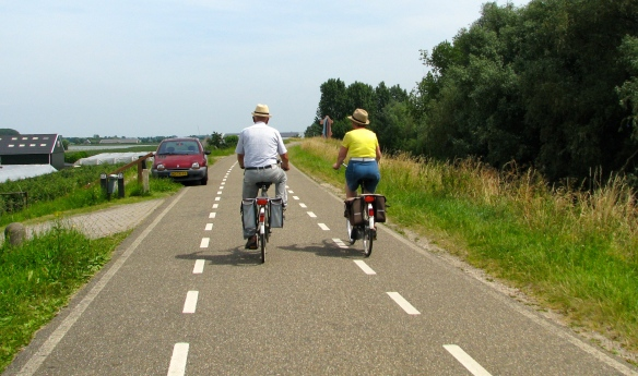 An older couple riding the bike paths of Holland